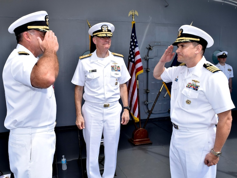 POLARIS POINT, Guam (Oct. 21, 2016) Capt. Douglas A. Bradley, right, relieves Capt. Mark A. Prokopius, left, as commanding officer of the submarine tender USS Emory S. Land (AS 39) as Rear Adm. Frederick J. Roegge, commander of Submarine Force, U.S. Pacific Fleet, presides. The change-of-command ceremony was held aboard Emory S. Land. (U.S. Navy photo by Seaman Daniel S. Willoughby/RELEASED)