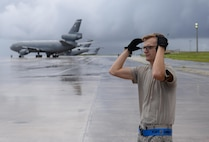 Senior Airman Dylan Cruson, 734th Air Mobility Squadron aircraft services technician, directs a Tunner 60K aircraft cargo loader as it backs away from a Boeing C-17 Globemaster III August 18, 2016, at Andersen Air Force Base, Guam. The assistance of the 734th AMS enabled the 36th Wing Chapel to efficiently distribute a large amount of coffee to the base, boosting morale and raising awareness to the Chaplain Corps mission. (U.S. Air Force photo by Airman 1st Class Jacob Skovo)