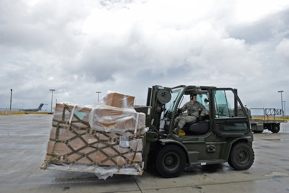 Staff Sgt. Randy Adkison, 734th Air Mobility Squadron freight supervisor, uses a forklift to transport a pallet of coffee August 18, 2016, at Andersen Air Force Base, Guam. The 36th Wing Chapel uses coffee as a tool to bridge the gap between service members and the Chaplain Corps. (U.S. Air Force photo by Airman 1st Class Jacob Skovo)