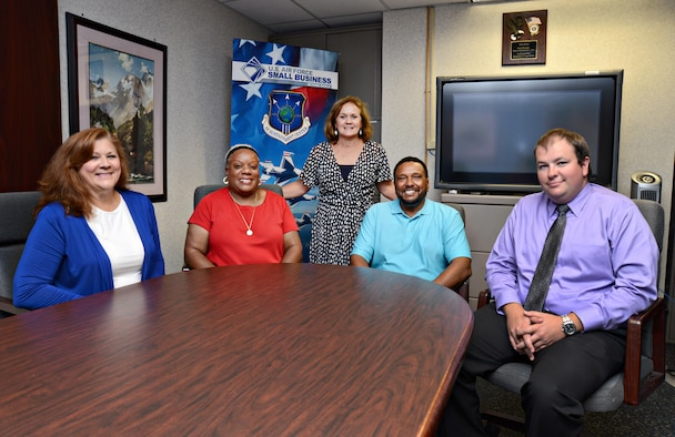 Team members from the AFSC OC-ALC Tinker Small Business Office are, from left, Terri Shook, the procurement center representative from the Small Business Administration; Renaye Tyce; Tracy Nicholson; Richard Scroggins; and Chase Washburn, a Copper Cap intern. (Air Force photo by Kelly White)