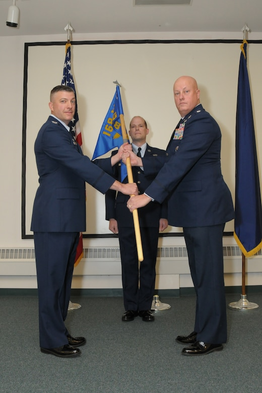 Lt. Col. Jack Evans accepts the 168th Mission Support Group guidon from Col. Torrence Saxe, commander of the 168th Wing, Alaska Air National Guard, and officially assumes command of the group during a ceremony held October 24, 2016 at Eielson AFB, Alaska. Evans had previously commanded the 176th Civil Engineer Squadron at Joint Base Elmendorf-Richardson, Anchorage, Alaska and has served in multiple leadership roles from battalion to headquarters Air Staff. (U.S. Air National Guard photo by Senior Master Sgt. Paul Mann/Released)