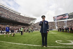 "U.S. Air Force Master Sgt. Eric Sullivan, a baritone vocalist with the United States Air Force Band's ""Singing Sergeants"", sings ""The Star-Spangled Banner"" before an NFL football game at Soldier Field in Chicago, Ill., Oct. 2, 2016. Sullivan performed the national anthem for an audience of more than 60,800 people as part of the unit's community relations mission. (U.S. Air National Guard photo by Tech. Sgt. Lealan Buehrer)"