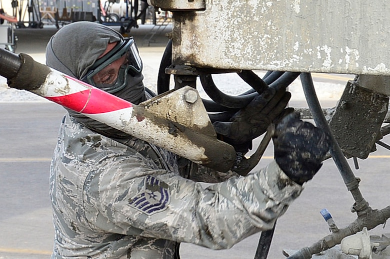 Tech. Sgt. Michael Massey, 386th Expeditionary Civil Engineering Squadron pavements and equipment craftsman, pours concrete at an undisclosed location in Southwest Asia 24 Oct., 2016. The 386th ECES is expanding sunshades to prepare for an upcoming transition from MQ-1 Predators to MQ-9 Reapers. (U.S. Air Force photo by Capt. Casey Osborne/Released)