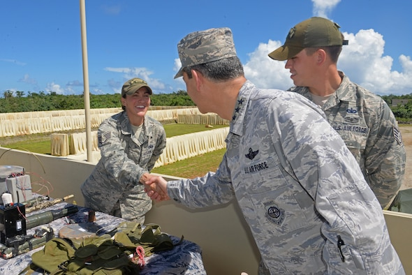 U.S. Air Force Lt. Gen. Kenneth Wilsbach, 11th Air Force commander, greets Staff Sgt. Chelsey Coolidge, left, 736th Security Forces Squadron commando warrior instructor, Oct. 27, 2016, at Andersen Air Force Base, Guam. During his visit, Wilsbach met with Airmen and hosted an all call where he spoke with Airmen and answered their questions. (U.S. Air Force photo by Airman 1st Class Alexa Ann Henderson)