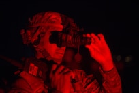 A U.S. Soldier assigned to the 39th Brigade Engineering Battalion, 101st Airborne Division (Air Assault), adjusts his night vision goggles at Qayyarah West Airfield, Oct. 25, 2016. More than 60 coalition partners have committed themselves to the goals of eliminating the threat posed by the Islamic State of Iraq and the Levant and have contributed in various capacities to the effort to combat ISIL in Iraq, the region and beyond.  (U.S. Army photo by Spc. Christopher Brecht)