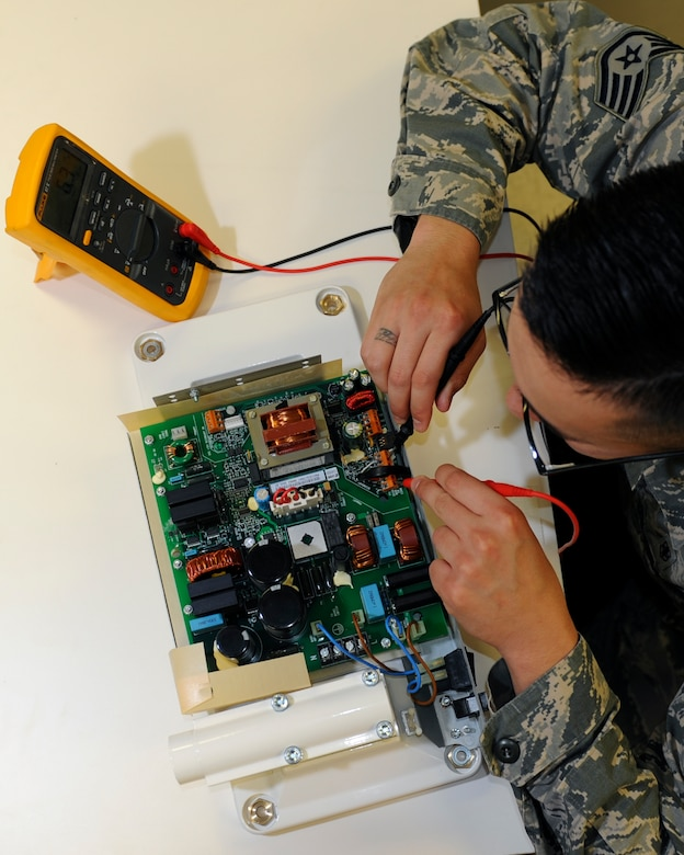 U.S. Air Force Staff Sgt. Pablo Novel-Valdez, a biomedical equipment technician with the 509th Medical Support Squadron, checks the settings of a dental x-ray power board at Whiteman Air Force Base, Mo., Oct. 13, 2016. Each item at the medical group facility is checked for compliance prior to patient use. (U.S. Air Force photo by Senior Airman Danielle Quilla)