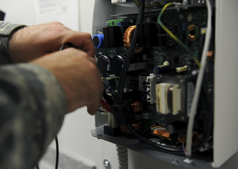 U.S. Air Force Senior Airman Lance Voegtline, a biomedical equipment technician with the 509th Medical Support Squadron, calibrates a dental x-ray power board at Whiteman Air Force Base, Mo., Oct. 13, 2016. The equipment items assigned to the medical group are inspected against manufacture, National Fire Protection Association and industry standards (U.S. Air Force photo by Senior Airman Danielle Quilla)