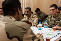 U.S. Army Gen. Joseph Votel, Commander of the United States Central Command, discusses battle plans with Iraqi security forces at Qayyarah West, Iraq, Oct. 25, 2016. More than 60 coalition partners have committed themselves to the goals of eliminating the threat posed by the Islamic State of Iraq and the Levant and have contributed in various capacities to the effort to combat ISIL in Iraq, the region and beyond.  (U.S. Army photo by Spc. Christopher Brecht)