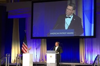 Defense Secretary Ash Carter thanks the National Defense University Foundation for recognizing the men and women of the Defense Department with the Patriot Award during a ceremony at the Reagan Building in Washington, D.C.,  Oct. 27, 2016. DoD photo by Jim Garamone