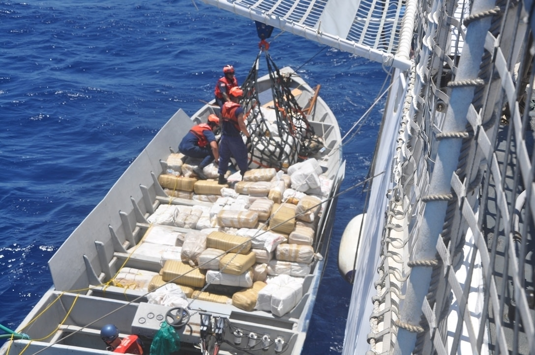 Coast Guardsmen from the Coast Guard Cutter Stratton from Alameda, Calif., unload narcotics from a smuggling vessel intercepted by the crew in the Eastern Pacific Ocean. (Coast Guard photo by Cutter Stratton)