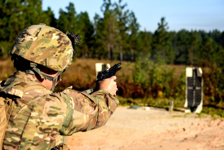 Senior Airman Parker White, a combat arms training and maintenance instructor with the 1st Special Operations Security Forces Squadron, fires an M9 pistol during Task Force Exercise Southern Strike at Camp Shelby, Miss., Oct 23, 2016. Air Commandos received in-depth weapons training from combat arms training and maintenance instructors with the 1st SOSFS. (U.S. Air Force photo by Senior Airman Jeff Parkinson)