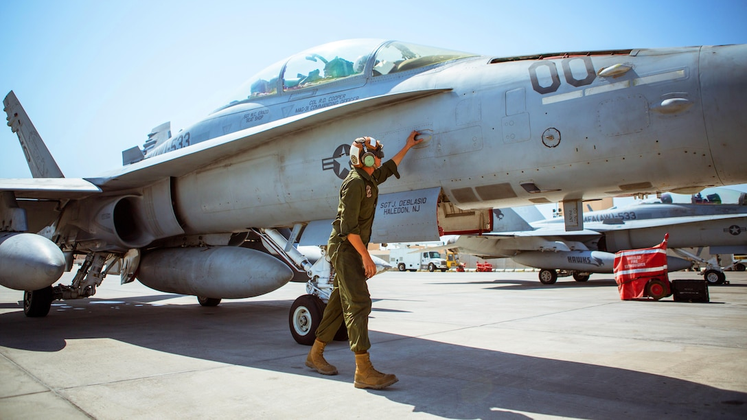 A U.S. Marine with Marine All-Weather Fighter Attack Squadron 533, Special Purpose Marine Air-Ground Task Force - Crisis Response - Central Command 16.2, inspects an F/A-18D before takeoff at an undisclosed location in Southwest Asia, Oct. 15, 2016. VMFA(AW)-533 departed the CENTCOM area of responsibility, completing deployment as part of the Aviation Combat Element of SPMAGTF-CR-CC.  The squadron conducted strikes in support of Operation Inherent Resolve, the operation to eliminate the ISIL terrorist group and the threat they pose to Iraq, Syria, and the wider international community. (U.S. Marine Corps photo by Sgt. Donald Holbert)
