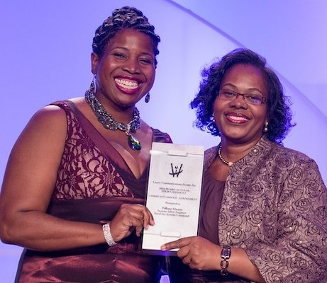 "DETROIT, Mich. – Navy engineer Tiffany Owens, left, receives the Women of Color Magazine's 2016 Community Service Award at the magazine's annual awards gala held at the Detroit Marriott in the Renaissance Center, Oct. 15. Owens was honored for inspiring and mentoring students throughout Virginia in a myriad of science, technology, engineering and mathematics programs. ""In serving our country as a systems safety engineer at the Naval Surface Warfare Center Dahlgren Division, Tiffany Owens has also gone above and beyond in service to her community,"" said Karen Davis, Naval Sea Systems Command Executive Director for Surface Warfare, told the audience before presenting the award to Owens."