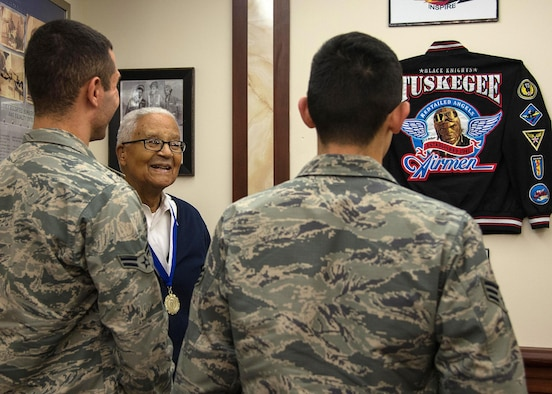 Retired Col. Charles E. McGee, an original Tuskegee Airman, speaks with Airmen during a visit to Hanscom Air Force Base, Mass., Oct. 27. Senior Airman Alfredo Maldonado, right, and Airman 1st Class Quinton Coke, both personnelist with the 66th Force Support Squadron, and other Airmen from Hanscom, met with McGee who spoke about lessons learned, Air Force history and challenged each Airmen to believe in themselves. (U.S. Air Force photo by Mark Herlihy)