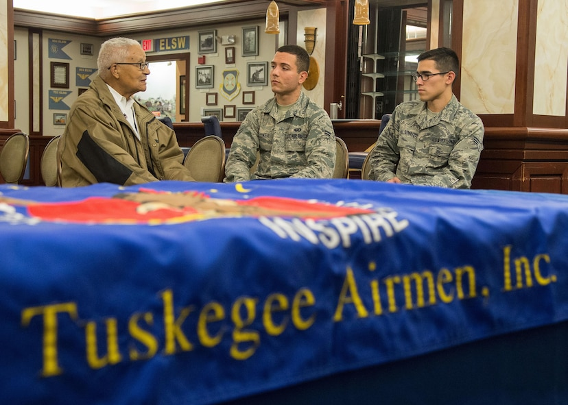Retired Col. Charles E. McGee, an original Tuskegee Airman, speaks with Senior Airman Alfredo Maldonado, right, and Airman 1st Class Quinton Coke, both personnelist with the 66th Force Support Squadron, during a visit to Hanscom Air Force Base, Mass., Oct. 27. McGee met with Airmen prior to speaking at an event in Boston co-hosted by the New England Tuskegee Airmen Chapter and the local chapter bearing his name. (U.S. Air Force photo by Mark Herlihy)