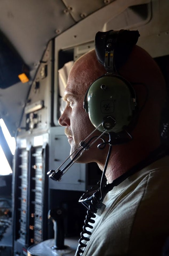 Staff Sgt. John McDermott, 94th Maintenance Squadron avionics instruments and flight control, observes an engine test from the flight deck to ensure repairs are effective at Dobbins Air Reserve Base on September 28, 2016. The maintainers wear headphones to communicate with one another while the thunderous engines are running. (U.S. Air Force photo by Senior Airman Lauren Douglas)