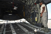 Staff Sgt. Malcolm Young, 94th Aircraft Maintenance Squadron hydraulics specialist, opens the ramp in the rear of a C-130 at Dobbins Air Reserve Base, Georgia on September 29, 2016. Young is responsible for equipment which hydraulic power is needed such as flight controls, landing gear, steering, brakes, etc. (U.S. Air Force photo by Senior Airman Lauren Douglas)
