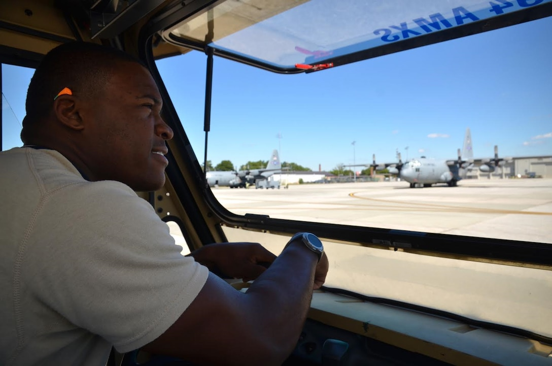 Staff Sgt. Malcolm Young, 94th Aircraft Maintenance Squadron hydraulics specialist, drives on the flight line to one of the parked C-130 aircraft at Dobbins Air Reserve Base, Georgia on September, 29, 2016. Young's hydraulic work keeps the planes in the air so pilot's can fly their missions and save lives. (U.S. Air Force photo by Senior Airman Lauren Douglas)