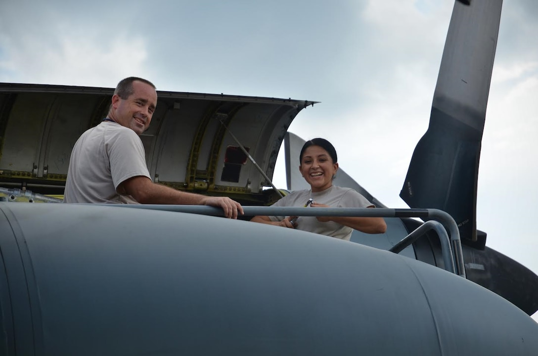 Airman 1st Class Cindy Esquero, 94th Maintenance Squadron avionics guidance and controls, replaces a tachometer generator under the guidance of Technical Sgt. John Halliday, 94th MXS at Dobbins Air Reserve Base on September 27, 2016. Esquero is on seasonal orders to learn to maintain the various parts of the C-130. (U.S. Air Force photo by Senior Airman Lauren Douglas)