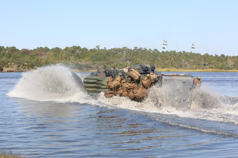 An amphibious assault vehicle carrying Marines with 3rd Battalion, 8th Marine Regiment traverses through water before conducting a simulated sea-to-shore attack at Camp Lejeune, N.C., Oct. 24, 2016. Marines with 3rd Bn., 8th Marines, tested their warfighting abilities and combat readiness through a Marine Corps Combat Readiness Evaluation in preparation for an upcoming deployment. (U.S. Marine Corps photo by Sgt. Clemente C. Garcia)