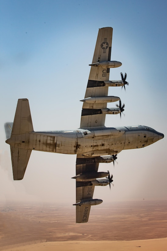 A KC-130J with Marine Aerial Refueler Transport Squadron 352, turns in descent before landing during a Special Purpose Marine Air-Ground Task Force - Crisis Response - Central Command aerial refueling exercise, Oct. 13, 2016. SPMAGTF-CR-CC is a self-sustaining expeditionary unit, designed to provide a broad range of crisis response capabilities throughout the Central Command area of responsibility, using organic aviation, logistical, and ground combat assets, to include TRAP and embassy reinforcement. (U.S. Marine Corps photo by Cpl. Trever Statz)