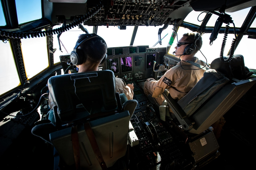 U.S. Marine Corps KC-130J pilots with Marine Aerial Refueler Transport Squadron 352, take part in a Special Purpose Marine Air-Ground Task Force - Crisis Response - Central Command aerial refueling exercise, Oct. 13, 2016. SPMAGTF-CR-CC is a self-sustaining expeditionary unit, designed to provide a broad range of crisis response capabilities throughout the Central Command area of responsibility, using organic aviation, logistical, and ground combat assets, to include TRAP and embassy reinforcement. (U.S. Marine Corps photo by Cpl. Trever Statz)
