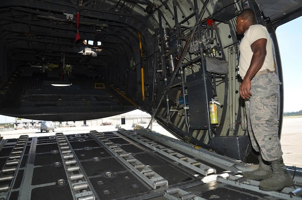 Staff Sgt. Malcolm Young, 94th Aircraft Maintenance Squadron hydraulics specialist, opens the rear ramp of a C-130 on the flight line at Dobbins Air Reserve Base, Georgia on September 29, 2016. Young is responsible for equipment in which hydraulic power is needed such as flight controls, landing gear, steering, brakes, etc. (U.S. Air Force photo by Senior Airman Lauren Douglas)