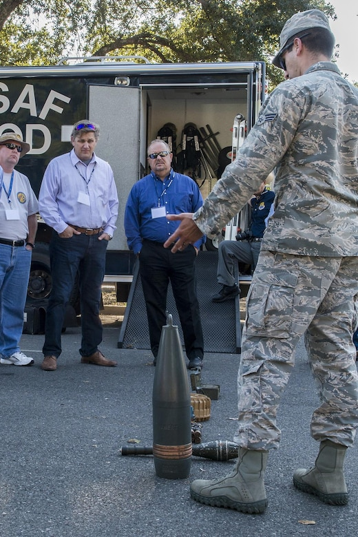 A group of civic leaders get a briefing by an 2nd Bomb Wing Explosive Ordnance Disposal team member during a tour at Barksdale Air Force Base, La., Oct. 27, 2016. The tour was hosted by the 433rd Airlift Wing from Lackland Air Force Base, Texas, and travel to Barksdale to get first hand look at the different missions throughout the Air Force Reserve Command. (U.S. Air Force photo by Master Sgt. Greg Steele/Released)