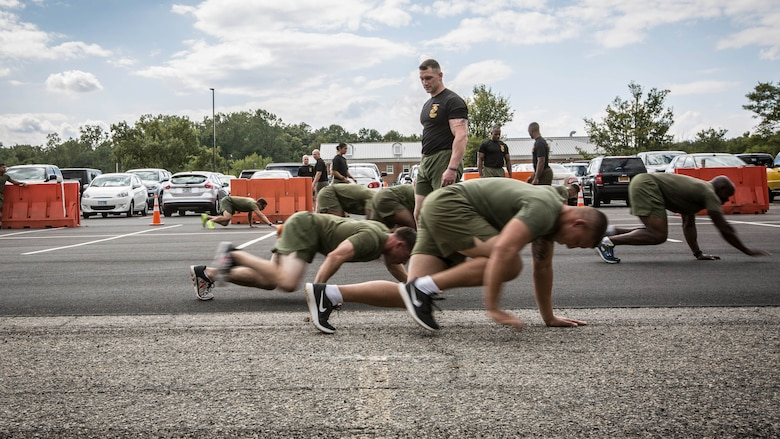 A Force Fitness Instructor (FFI) Trainer monitors the class of FFI students conducting bear crawls during the physical training portion of their course requirement at Corps Base Quantico, Virginia, October 3, 2016. The FFI course is made up of physical training, classroom instruction and practical application to provide the students with a holistic approach to fitness. Upon completion, the Marines will return to serve as unit FFIs, capable of designing individual and unit-level holistic fitness programs.