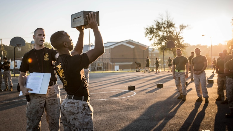 Force Fitness Instructor (FFI) Trainers demonstrate proper ammo can lift technique for the class of FFI students before executing practical application as part of their course requirement at Marine Corps Base Quantico, Virginia, October 4, 2016. The FFI course is made up of physical training, classroom instruction and practical application to provide the students with a holistic approach to fitness. Upon completion, the Marines will serve as unit FFIs, capable of designing individual and unit-level holistic fitness programs.