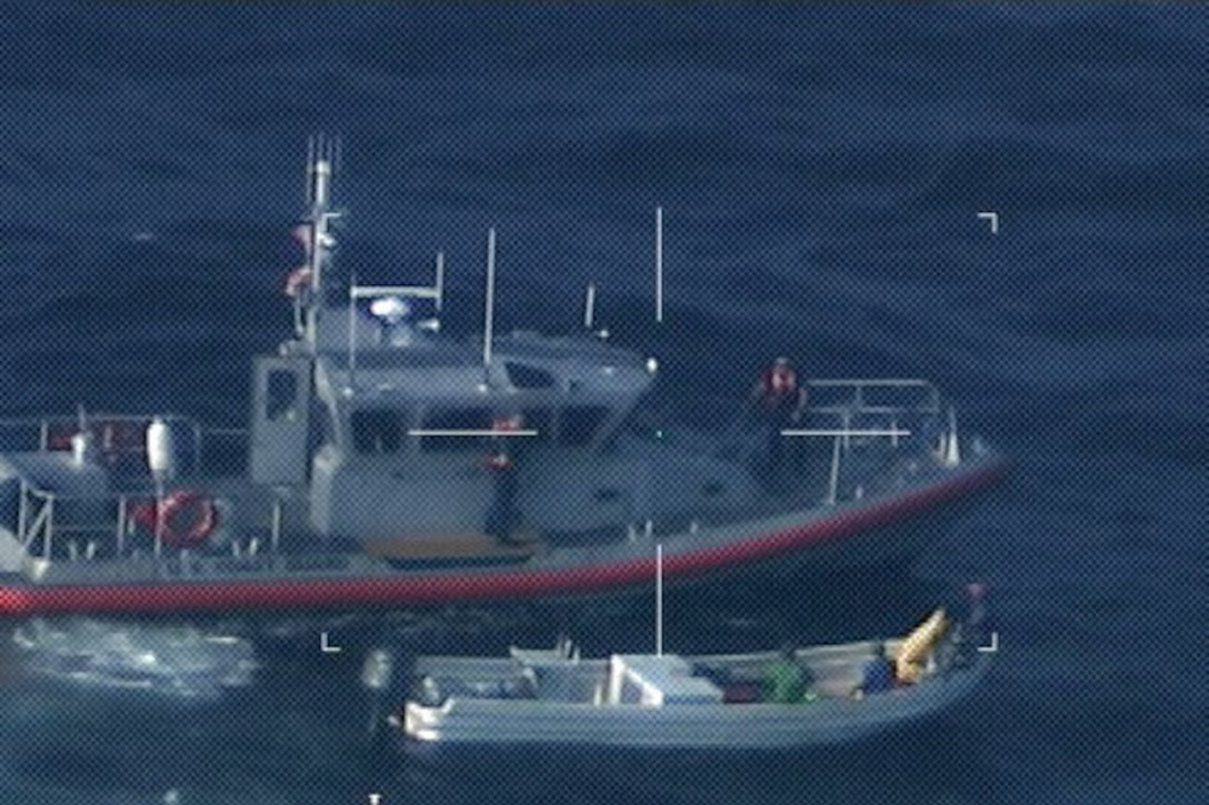 A Station South Padre Island boat crew pulls alongside a Lancha caught fishing illegally in gulf waters, Texas Dec. 11, 2015. Lanchas are Mexican fishing boats that poach thousands of pounds of wildlife from U.S. waters every year. (U.S. Coast Guard photo by Air Station Corpus Christi)