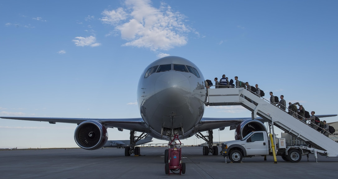 366th Fighter Wing personnel board an aircraft for a deployment to Southwest Asia in support of Operation Inherent Resolve, Sept. 30, 2016, at Mountain Home AFB, Idaho. Personnel across base worked together to ensure everything was ready for the deployment. (U.S. Air Force photo by Senior Airman Jeremy L Mosier/Released)