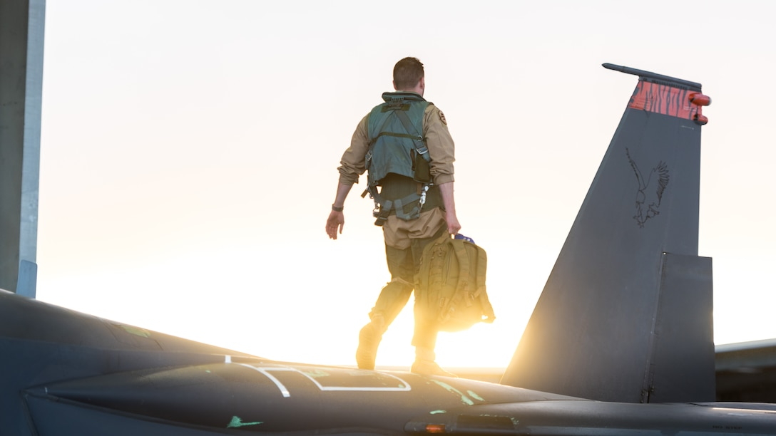 A pilot assigned to the 389th Fighter Squadron walks along the top of an F-15E Strike Eagle Oct. 1, 2016, at Mountain Home Air Force Base, Idaho. The 389th FS is currently deployed to Southwest Asia in support of Operation Inherent Resolve. (U.S. Air Force photo by Senior Airman Connor J. Marth/Released)
