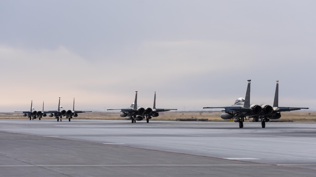 F-15E Strike Eagles taxi down the runway as they prepare to depart to Southwest Asia in support of Operation Inherent Resolve, Oct. 1, 2016, at Mountain Home Air Force Base, Idaho. Hundreds of Gunfighters have deployed in support combat operations across the globe.(U.S. Air Force photo by Senior Airman Connor J. Marth/Released)