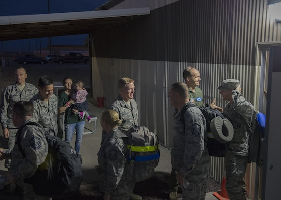 366th Fighter Wing leaders shake hands with members of the 726th Air Control Squadron before departing Mountain Home Air Force Base, Idaho for a deployment Oct.10, 2016. The 726th ACS members deployed to support operations in Southwest Asia. (U.S. Air Force photo by Airman 1st Class Chester Mientkiewicz/Released)