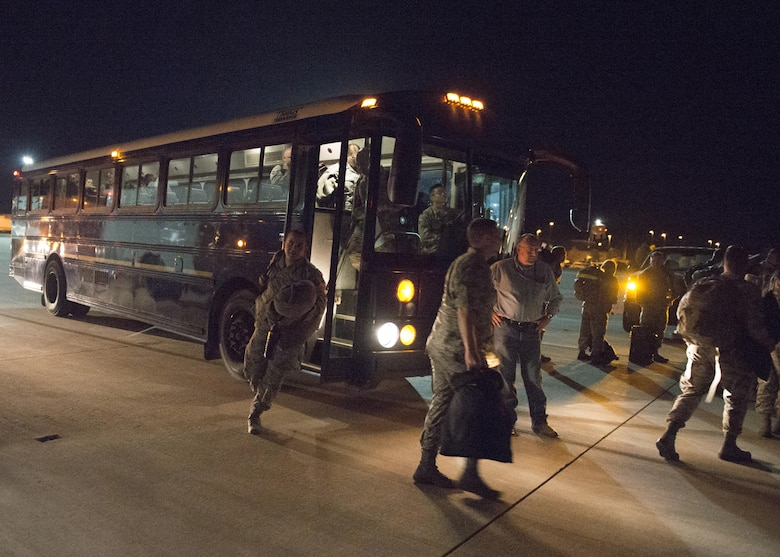 Members of the 726th Air Control Squadron depart from buses before boarding a plane to deploy from Mountain Home Air Force Base, Idaho, Oct. 10, 2016. The 726th ACS is a tenant unit stationed at Mountain Home AFB and assigned to the 552nd Air Control Group at Tinker AFB. The squadron is responsible for mobile, decentralized command and control of joint operations by conducting threat warning, battle management, theater missile defense, weapons control, combat identification and strategic communications. (U.S. Air Force photo by Airman 1st Class Chester Mientkiewicz/Released)