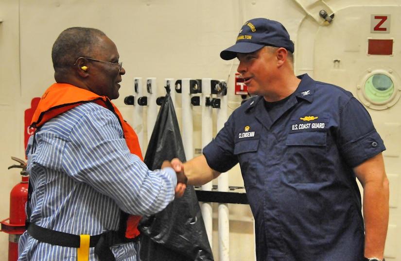 U.S. Coast Guard Capt. Scott Clendenin, U.S. Coast Guard cutter Hamilton (WMSL 753) commander, welcomes Jocelerme Privert, President of the Republic of Haiti, onboard the Hamilton off the coast of Jeremie, Haiti, Oct. 8, 2016.