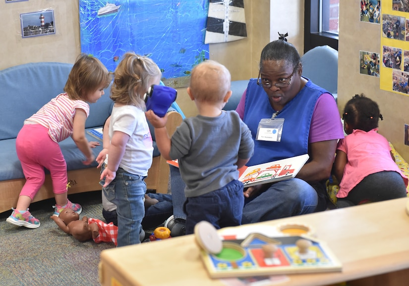 Patricia Bonneau, education technician, interacts with the children during play time at the Joint Base Charleston Child Development Center, Oct. 24, 2016. The CDC provides daytime care for children of Department of Defense members from six months to five years of age.