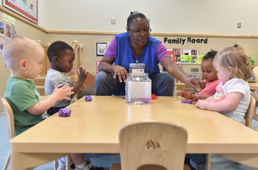 Patricia Bonneau, education technician, teaches children how to use playdough at the Joint Base Charleston Child Development Center, Oct. 24, 2016. The CDC provides daytime care for children of Department of Defense members from six months to five years of age. At the CDC, the children make the playdough used in the center for their learning activities.