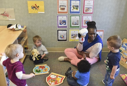 Yolonda Green, education technician, entertains children with a puppet during play time at the Joint Base Charleston Child Development Center, Oct. 24, 2016. The CDC provides daytime care for children of Department of Defense members from six months to five years of age.