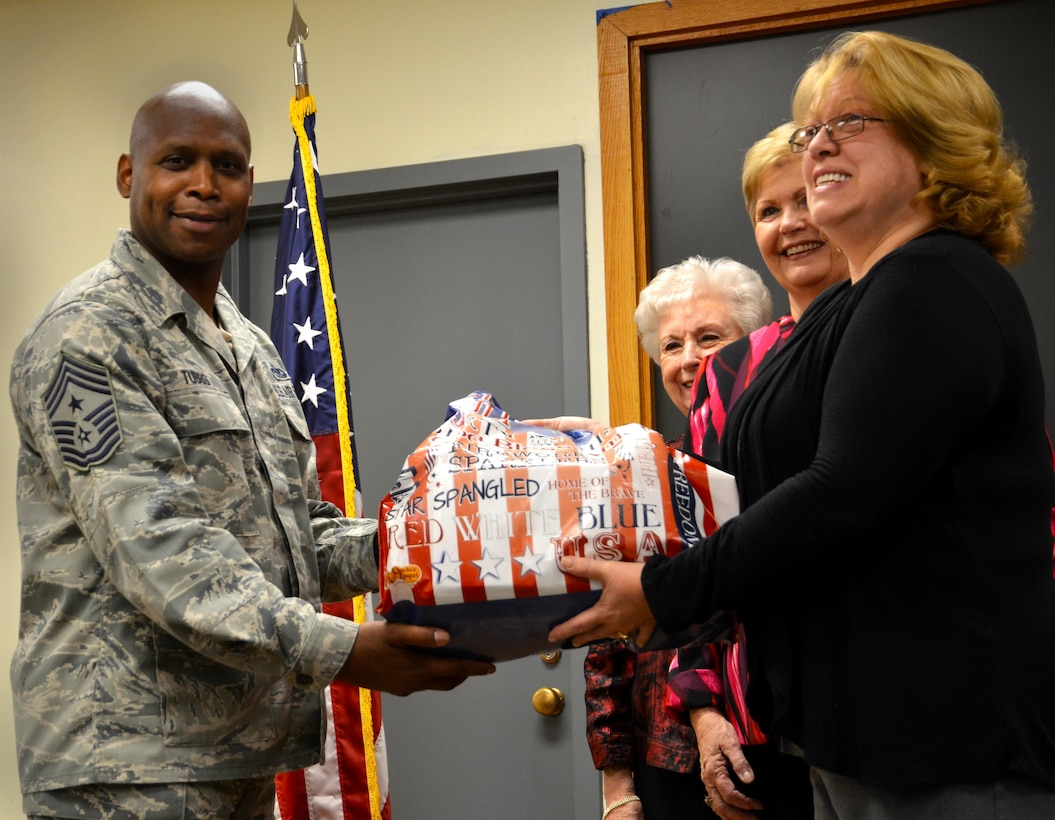 Chief Lyndon Tubbs, 94th Airlift Wing command chief, receives a donation of cards from Helen Skelton, Order of Eastern Star Grand Chapter of Georgia chairperson of operation at Dobbins Air Reserve Base, Georgia on October 25, 2016. The Eastern Stars gave over 10,000 cards to be sent to troops that may not be in the company of family this holiday. (U.S. Air Force photo by Senior Airman Lauren Douglas)