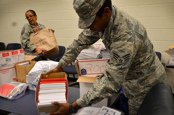 Senior Airman Justin Holt, 94th AW Aircraft Maintenance Squadron specialist, and other Airmen from the 94 Airlift wing came to help unload and receive the generous donation of holiday cards for deployed troops on October 25, 2016 at Dobbins Air Reserve Base, Georgia. The Eastern Stars gave over 10,000 cards to be sent to troops that may not be in the company of family this holiday. (U.S. Air Force photo by Senior Airman Lauren Douglas)