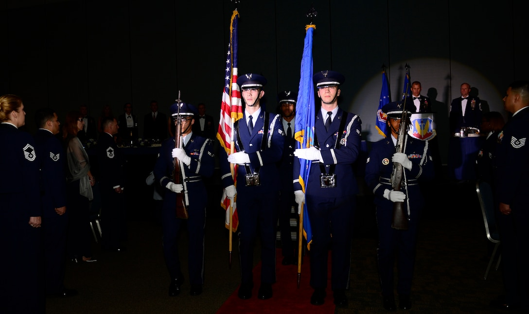 Airmen from the 633rd Air Base Wing Honor Guard present the colors during an Order of the Sword presentation ceremony at the Hampton Roads Convention Center in Hampton, Va., Oct. 27, 2016. The Order of the Sword is the highest honor and tribute enlisted Airmen can bestow upon a commissioned officer. It is patterned after two orders of chivalry founded during the Middle Ages in Europe and still in existence today - the Royal Order of the Sword and the Swedish Military Order of the Sword. (U.S. Air Force photo by Airman 1st Class Kaylee Dubois)