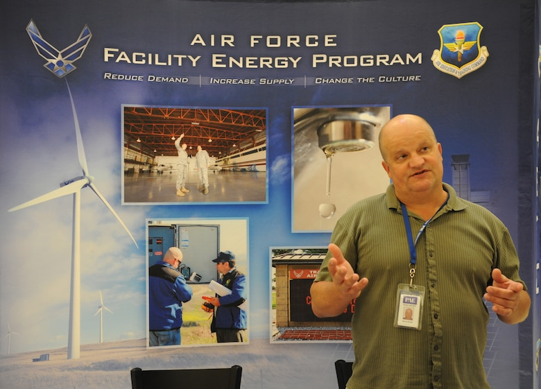 Bruce Groves, Base Operations Support installation energy manager, promotes Energy Action Month to Keesler personnel at the base exchange Oct. 28, 2016, on Keesler Air Force Base, Miss. The goals of Energy Action Month are to increase awareness about energy consumption and to encourage energy-saving actions in Airmen, civilians and their families.  (U.S. Air Force photo by Kemberly Groue/Released)