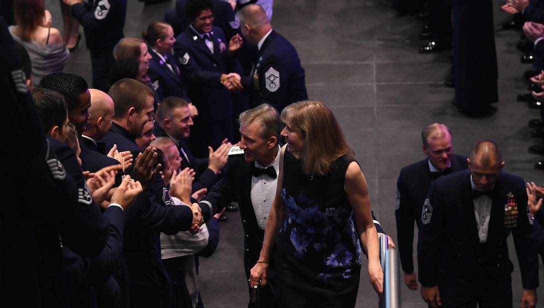 Gen. Hawk Carlisle, commander of Air Combat Command, is congratulated by Airmen as he walks up the stairs with his wife, Gillian Carlisle, before being honored during Order of the Sword Ceremony at the Hampton Roads Convention Center in Hampton, Va., Oct. 27, 2016. The Order of the Sword is the highest honor and tribute enlisted Airmen can bestow upon a commissioned officer. It is patterned after two orders of chivalry founded during the Middle Ages in Europe and still in existence today - the Royal Order of the Sword and the Swedish Military Order of the Sword. (U.S. Air Force photo by Staff Sgt. Nick Wilson)