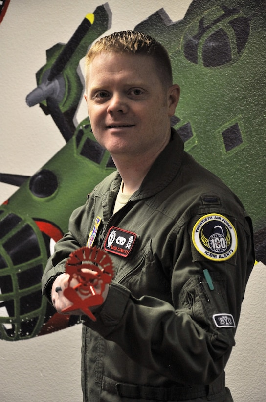 First Lt. Raun Carnley, 320th Missile Squadron missile combat crew commander shows off one of the new 20th Air Force alert milestone patches at F.E. Warren Air Force Base, Wyo., Oct. 27, 2016. Carnley's design was selected among several others for the entire missileer community.