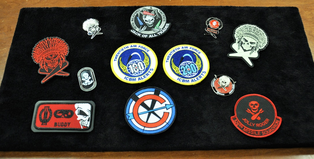 320th Missile Squadron missile combat crew commander, 1st Lt. Raun Carnley,  products sit on display at F.E. Warren Air Force Base, Wyo., Oct. 27, 2016. Carnley designs items believing these symbolic keepsakes stimulate better attitudes, morale and commitment to the mission.