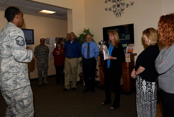 Master Sgt. Rodney McInnis, Airman & Family Readiness Center noncommissioned officer in charge, speaks to Terrie Hecker, wife of Maj. Gen. James Hecker, 19th Air Force Commander, and other key spouses Oct. 21, 2016, at the A&FRC on Columbus Air Force Base, Mississippi. McInnis spoke to the spouses about the center's Huggable Uniform Gifts that are provided to the families of deployed Airmen free of charge. Hecker's wife and the 19th Air Force command Chief visited various base facilities.