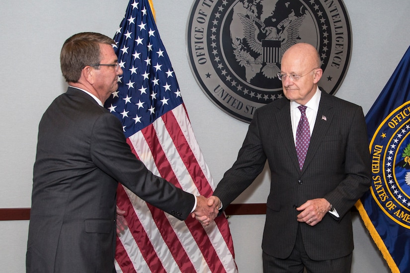 Defense Secretary Ash Carter congratulates James R. Clapper, the director of the Office of National Intelligence, during an award ceremony at the office's headquarters in Tysons Corner, Va., Oct. 28, 2016. Carter presented Clapper with the Distinguished Civilian Service Medal, the Defense Department's highest award. Office of the Director of National Intelligence photo