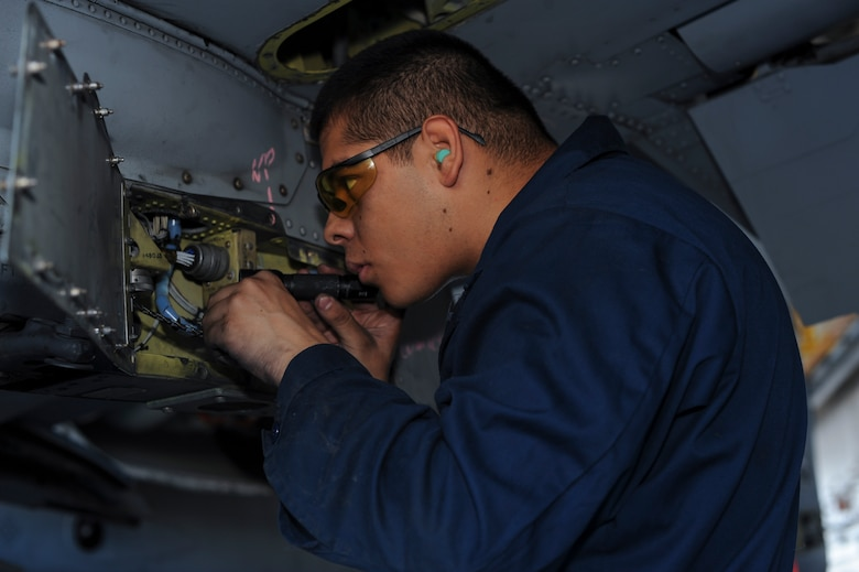 U.S. Air Force Airman 1st Class Elijah Escorcia-Luna, 355th Equipment Maintenance Squadron armament section team member, replaces dust caps and clamps on an A-10C Thunderbolt II at Davis-Monthan Air Force Base, Ariz., Oct. 19, 2016. The A-10 is capable of carrying bombs weighing up to 500 pounds and is also equipped with a 30 mm GAU-8/A seven-barrel Gatling gun. (U.S. Air Force photo by Airman 1st Class Ashley N. Steffen)